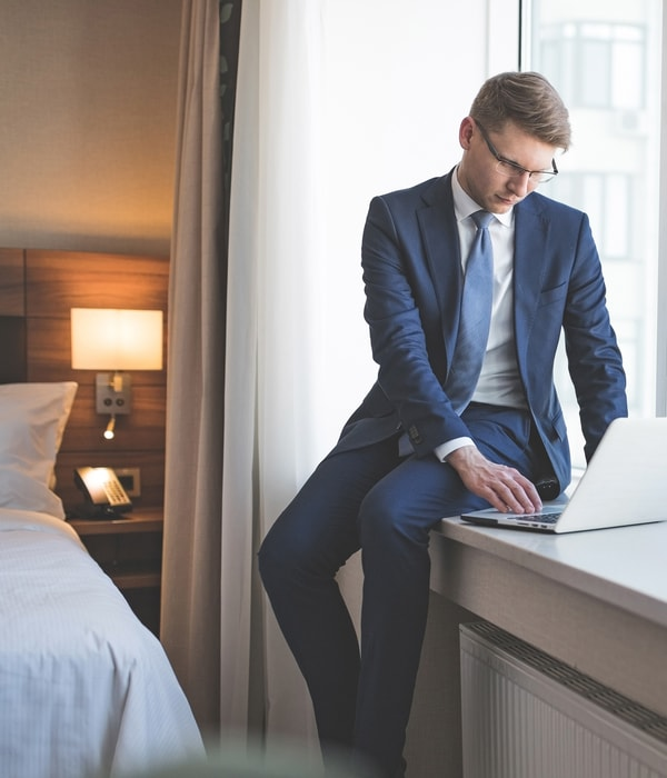 business-man-in-hotel-room-with-laptop